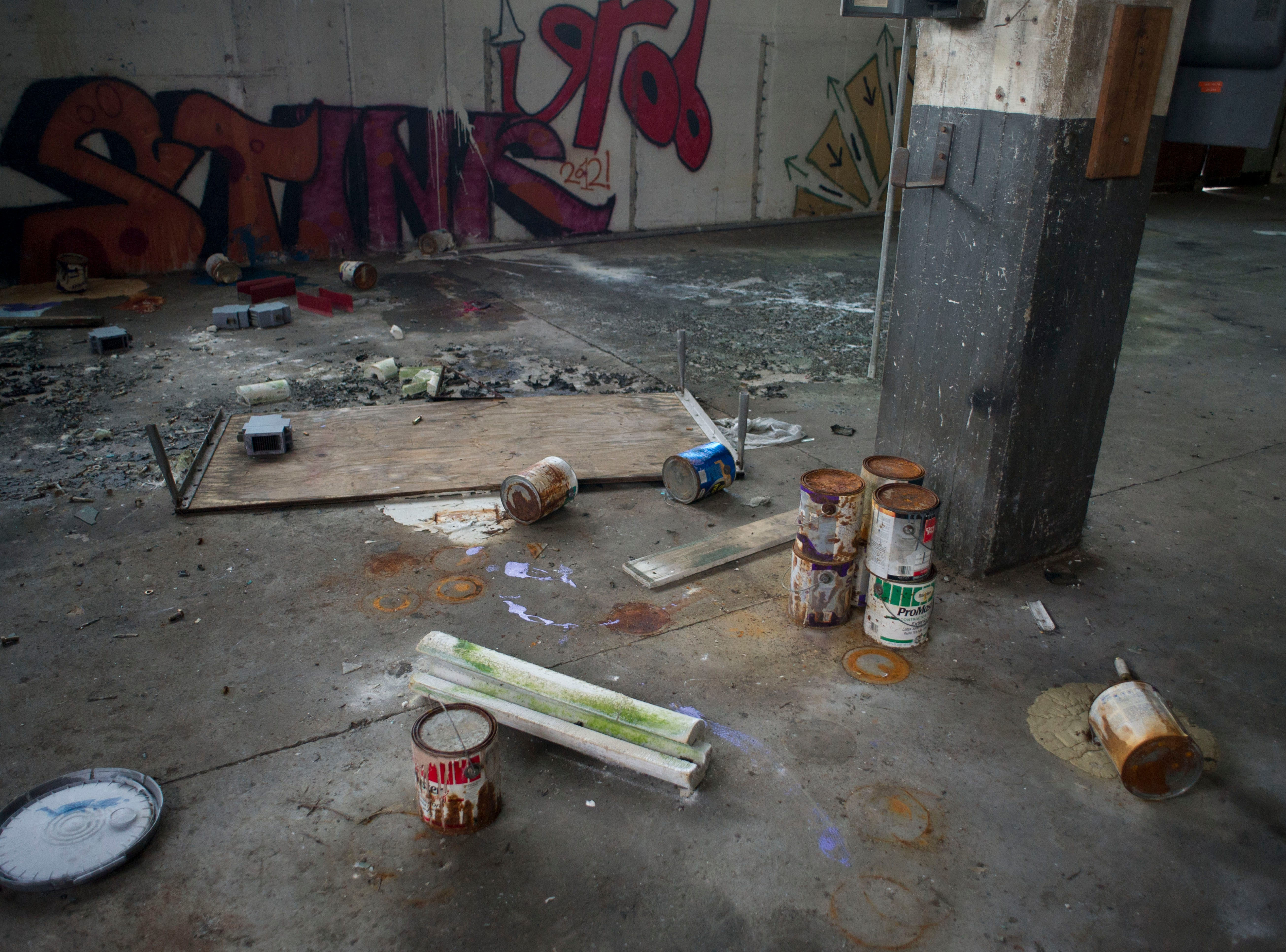Old paint cans and graffiti in the Standard Knitting Mill building on Thursday, November 15, 2012.