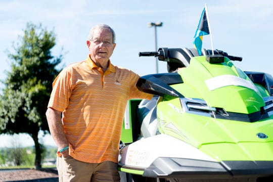 David Weech poses with his 2016 Yamaha WaveRunner in Knoxville on Tuesday, April 16, 2019. Weech, known as the holiday-themed Uber driver around town, is planning a trip from the west coast of Florida to the east coast and up to Montreal to raise money for Big Brothers Big Sisters of East Tennessee.