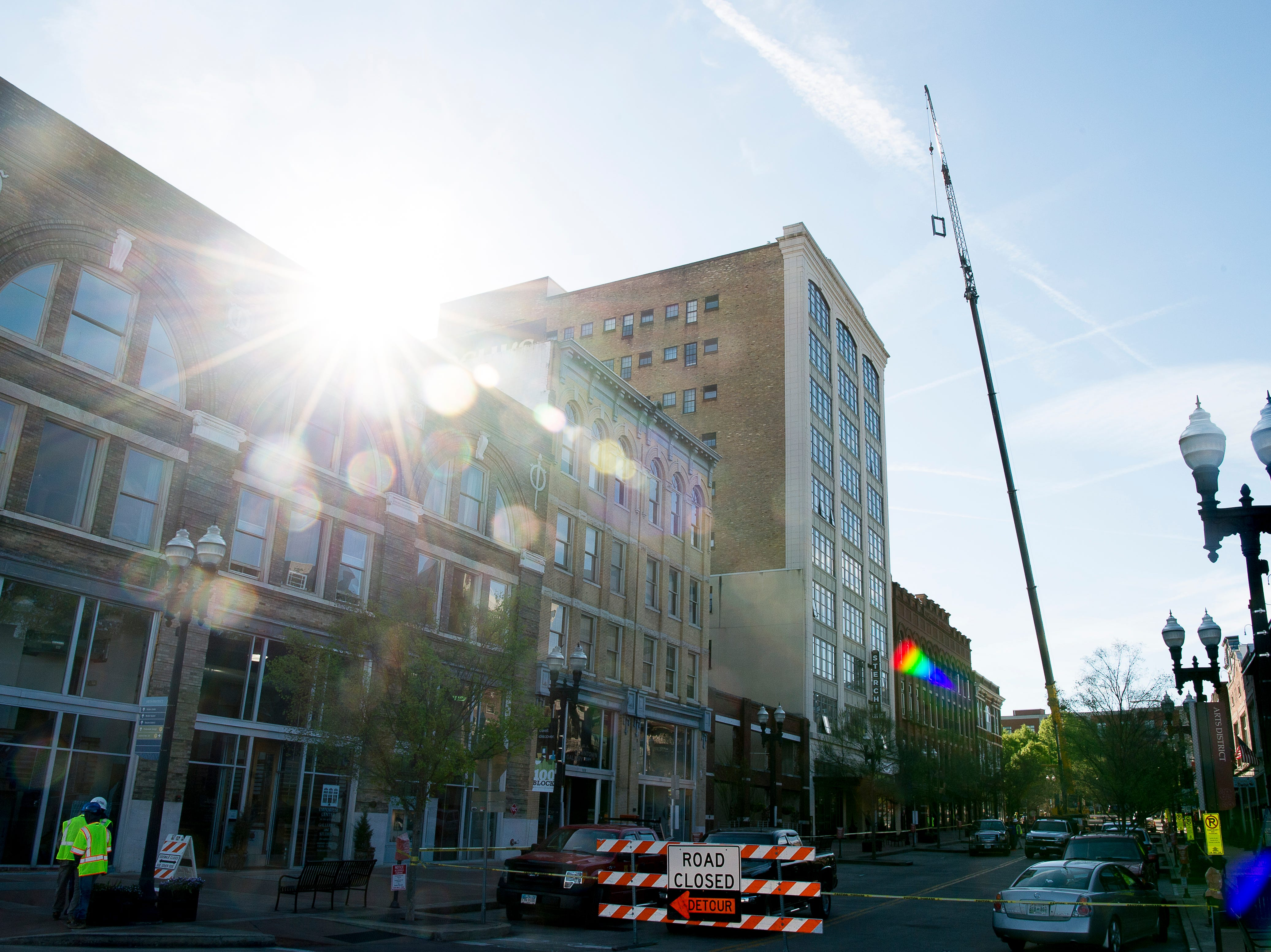 A crane hoists equipment to the roof of Sterchi Lofts in Knoxville, Tennessee on Tuesday, April 16, 2019. A new railing costing an estimated $70,000 is being installed to reopen the rooftop patio this summer.