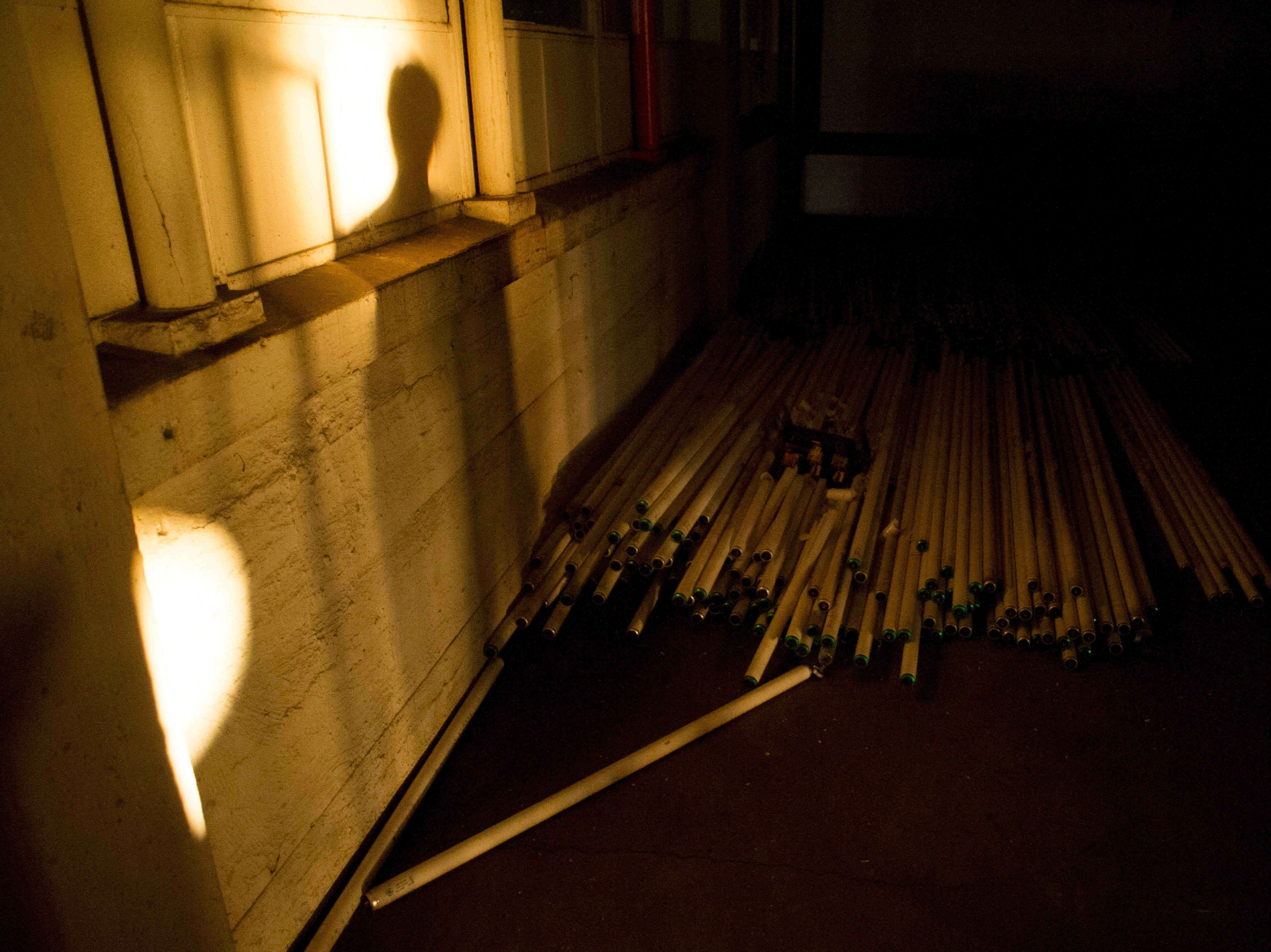 Fluorescent light tubes stored in a room at the Standard Knitting Mill building on Thursday, November 15, 2012.