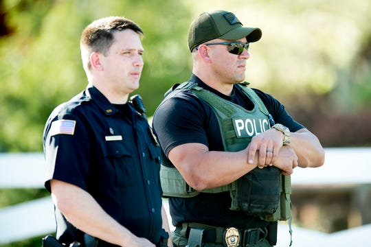 First responders stand watch at the scene of a shooting outside of Coach at the Tanger Outlet Mall in Sevierville, Tennessee on Tuesday, April 16, 2019. Two people including the assailant, were found dead at the scene with a third suffering from a gunshot wound.