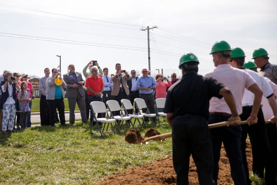 Community members take photos during a ground breaking ceremony for the new Tippecanoe County Public Library south branch, Tuesday, April 16, 2019, in Lafayette. This is the third branch the library has built this decade.
