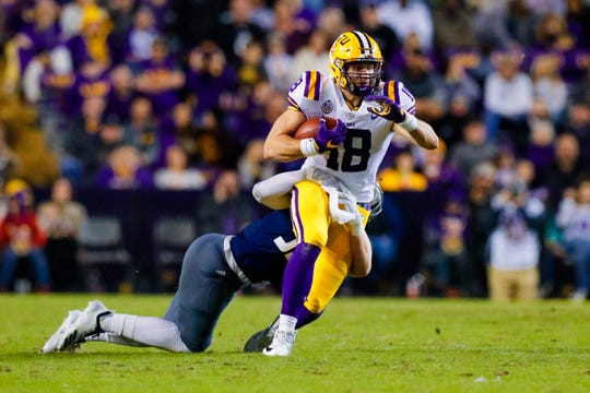 Nov 17, 2018; Baton Rouge, LA, USA;  LSU Tigers tight end Foster Moreau (18) runs against Rice Owls in the first half at Tiger Stadium. Mandatory Credit: Stephen Lew-USA TODAY Sports