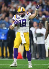 Jan 1, 2019; Glendale, AZ, USA; LSU Tigers tight end Foster Moreau celebrates a play in the second half against the UCF Knights in the 2019 Fiesta Bowl at State Farm Stadium. Mandatory Credit: Mark J. Rebilas-USA TODAY Sports