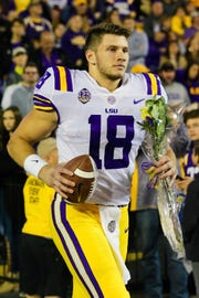 Nov 17, 2018; Baton Rouge, LA, USA;  LSU Tigers tight end Foster Moreau (18) runs out for Senior Night against Rice Owls at Tiger Stadium. Mandatory Credit: Stephen Lew-USA TODAY Sports