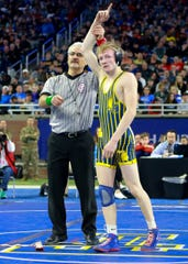 Kyle Kantola won the state Division 1 championship at 130 pounds on Saturday March 2, 2019 at Ford Field in Detroit.