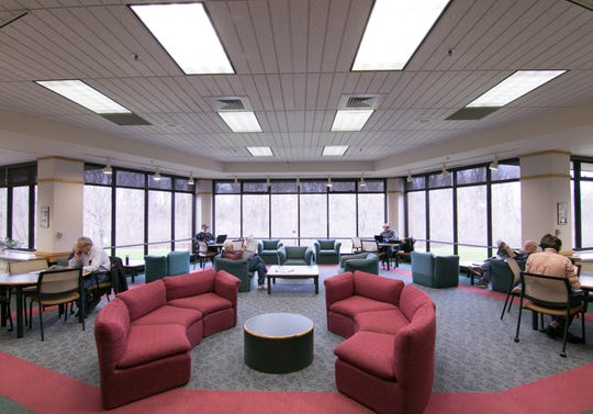 Improvements to the Brighton District Library will include a new fireplace in the center of this reading area, shown Tuesday, April 16, 2019.