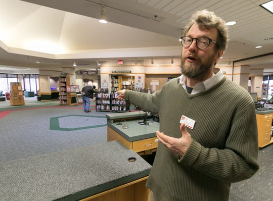 Brighton District Library Assistant Director Ed Rutkowski explains changes coming to the library, including new self-check stations in the center of the lobby Tuesday, April 16, 2019.