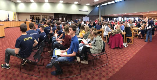 A Hartland High School board room is filled with students, staff and parents in support of baseball coach Brian Morrison Monday, April 15, 2019.