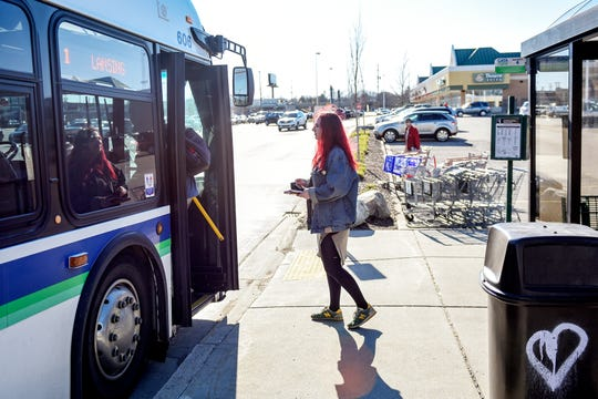 Lansing resident Ellen Dowling gets on a bus at the Frandor bus stop on Monday, April 15, 2019, in Lansing