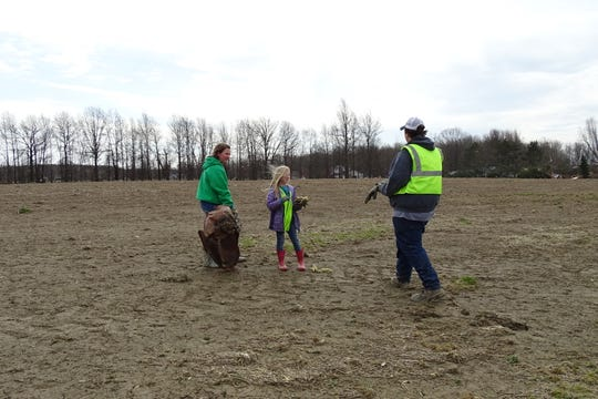 Shelby FFA members and their supporters volunteered to help clear debris from a field along Technology Parkway in Shelby on Tuesday.