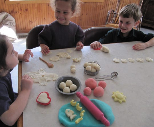 Gloria's children, Rayni and Austin, enjoy homemade play dough with their friend Heidi.