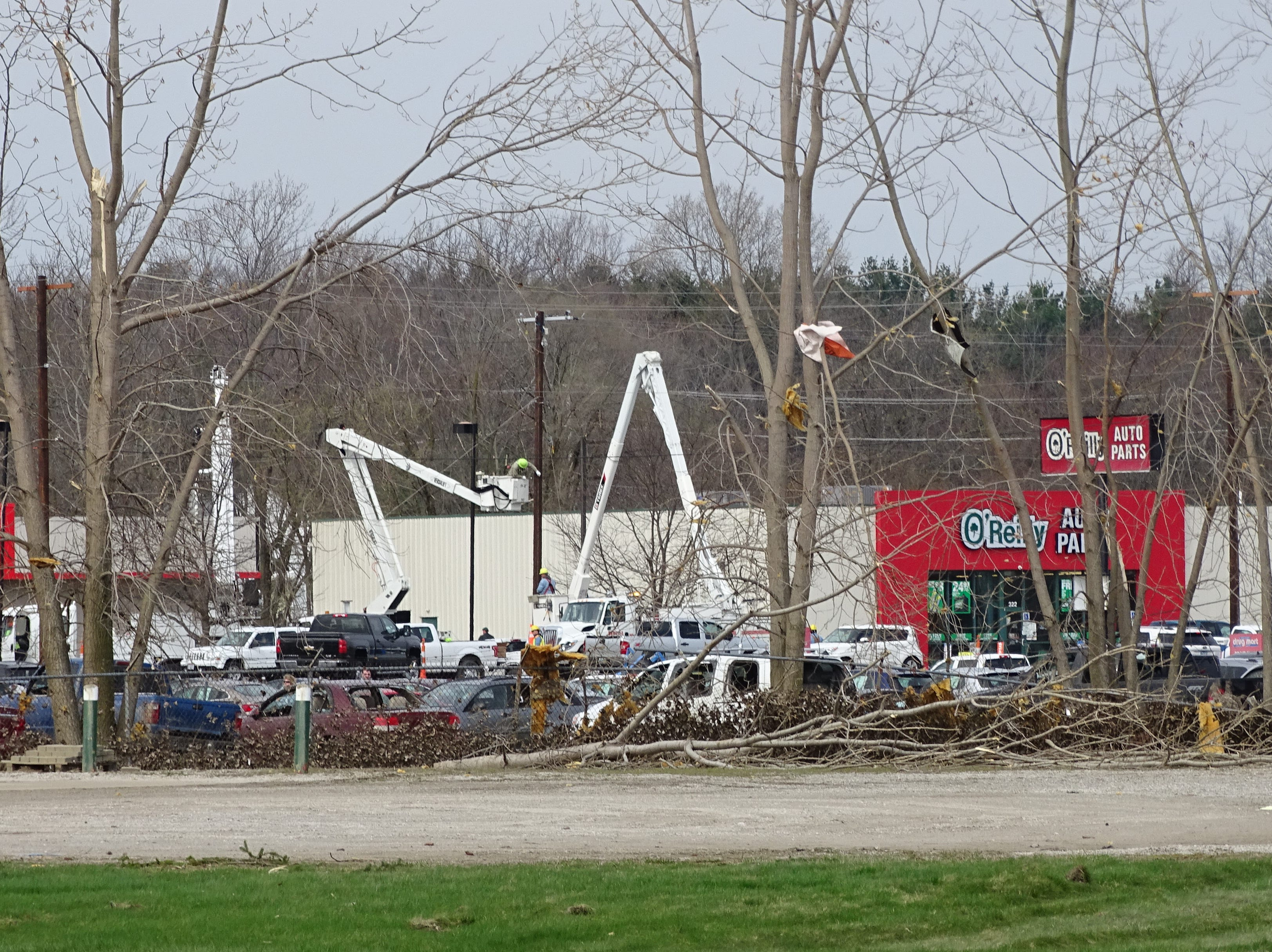 Where trees were felled by a tornado on Sunday, a forest of arm lifts sprouted on Tuesday as cleanup continues in Shelby.