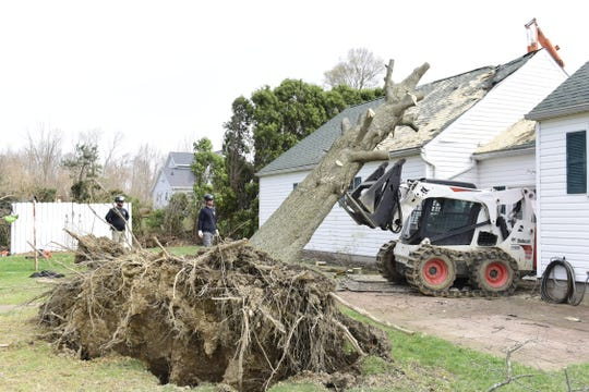 This garage on Wareham Road, hit by a tree, was one of the 107 structures affected by the April 14 twister that struck in Sharon, Jackson, Cass, Franklin, Blooming Grove and Butler townships. The EMA reported that the tornado destroyed 16 structures.