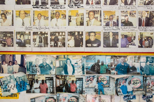 Photos of customers are seen on the walls of Uncle Lou's Fried Chicken at 3633 Millbranch Road.