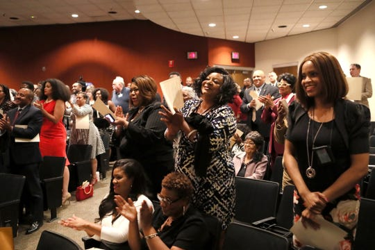 Attendees stand and applaud Phyllis Aluko as she is sworn in as Shelby County's first female chief public defender at the Walter L. Bailey, Jr. Criminal Justice Center on Tuesday, April 16, 2019.