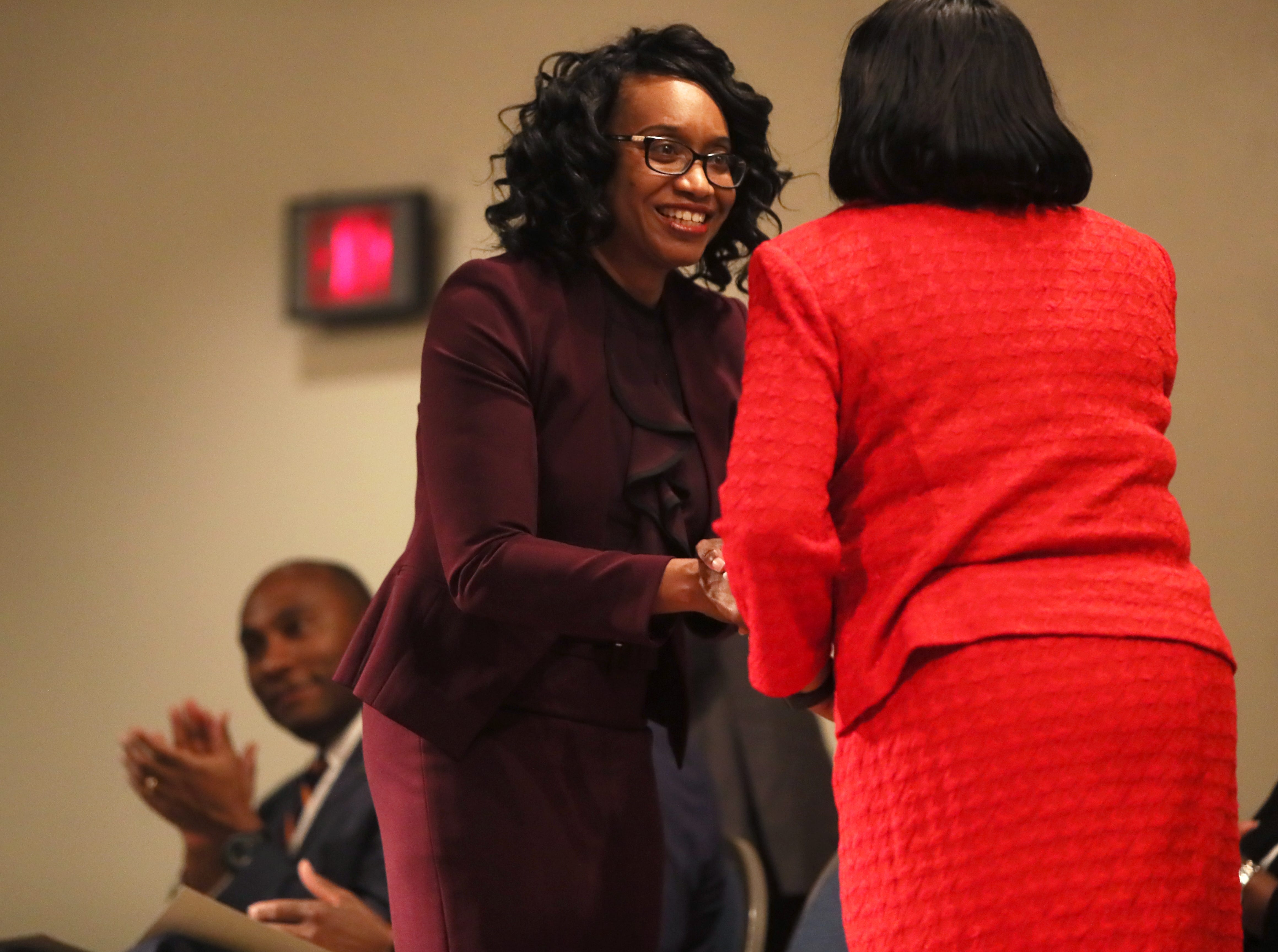Phyllis Aluko shakes the hand of Bernice Donald, U.S. Court of Appeals Sixth Circuit judge, before being sworn in as Shelby County's first female chief public defender at the Walter L. Bailey, Jr. Criminal Justice Center on Tuesday, April 16, 2019.