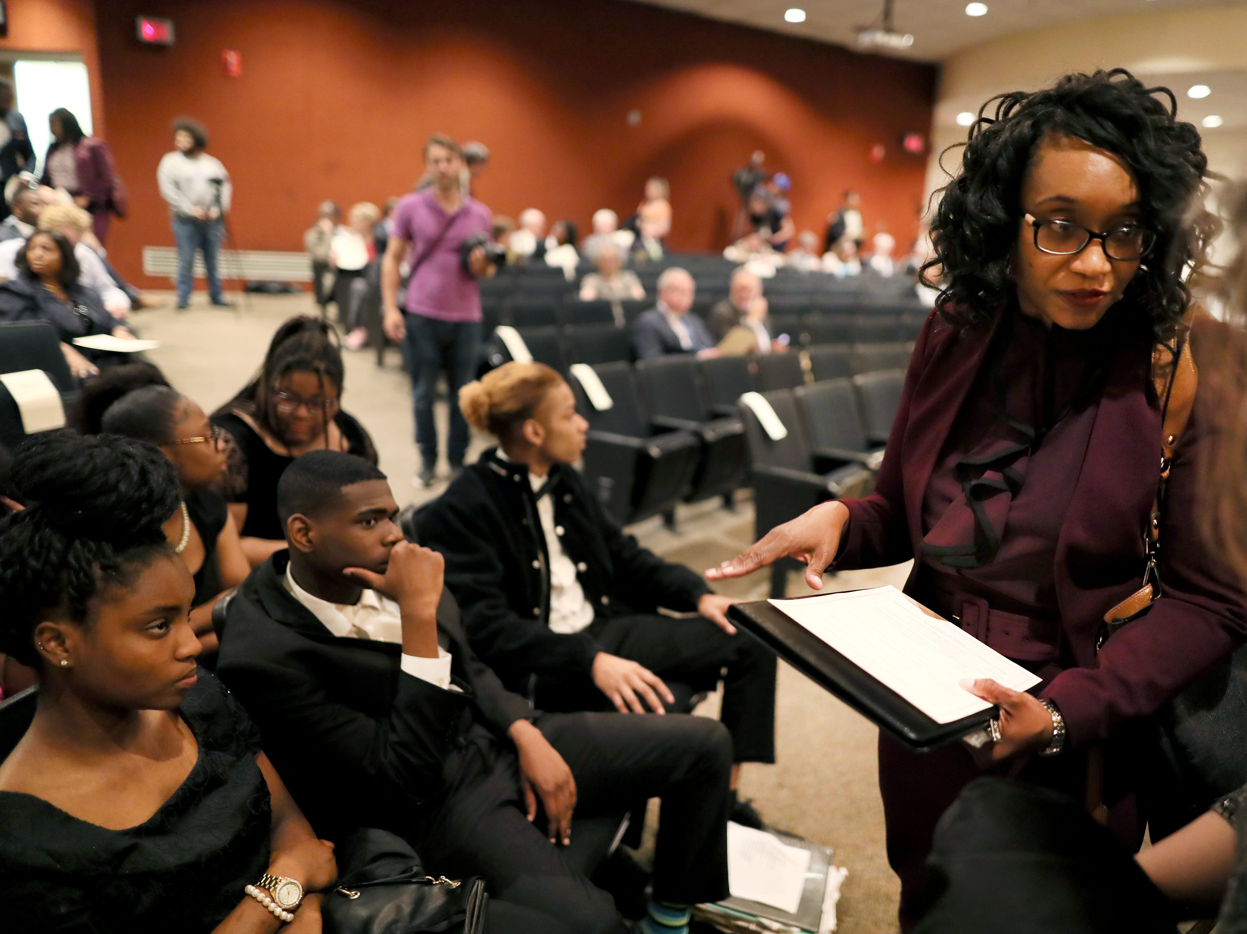 Phyllis Aluko speaks to the Whitehaven High School Choir, from her alma mater, before being sworn in as Shelby County's first female chief public defender at the Walter L. Bailey, Jr. Criminal Justice Center on Tuesday, April 16, 2019.