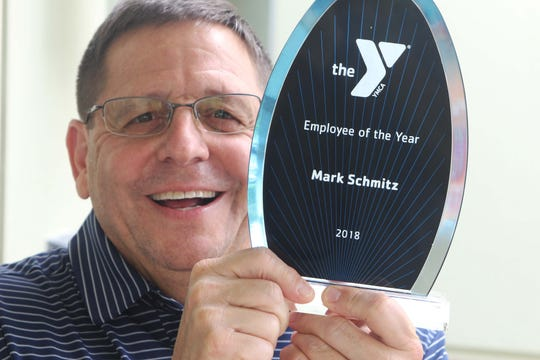Mark Schmitz displays his award.