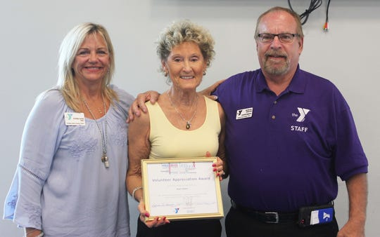 Volunteer of the Year Jean Shaw, center, is seen with Cindy Love, CEO, and Anthony DeLucia, community relations manager.