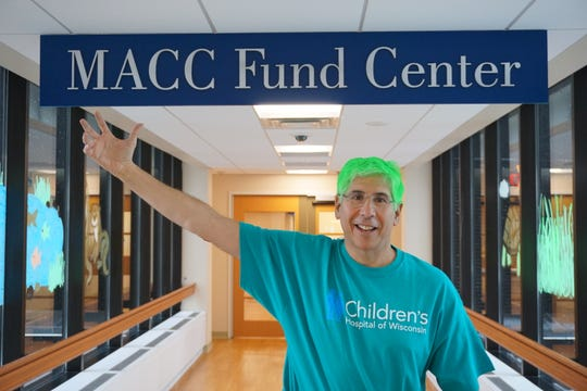 Dr. David Margolis lets his patients at Children's Hospital of Wisconsin spray his hair green in support of the Milwaukee Bucks during the 2019 NBA playoffs.