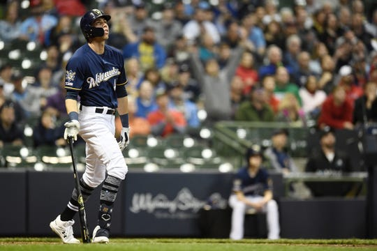 Christian Yelich watches his three-run home run during the sixth inning Monday night, the second of three homers he hit against the Cardinals in the series opener at Miller Park.