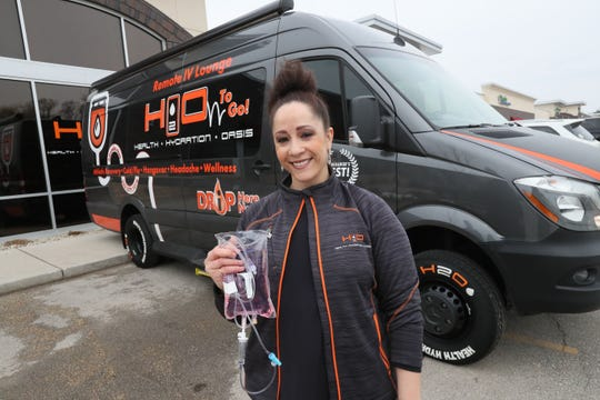 Dr. Alia Fox owns H20 Health Hydration Oasis in Brookfield. Here, she shows off her clinic's new bus that can be taken to just about any site to give people an IV for a variety of therapeutic purposes.
