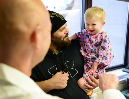 Robert Van Haren holds his laughing 3-year-old boy, BrentLee, during a follow-up visit to Children's Hospital on Feb. 7.