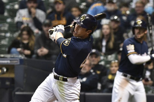 Brewers outfielder Christian Yelich hits his third home run of the game in the eighth inning.