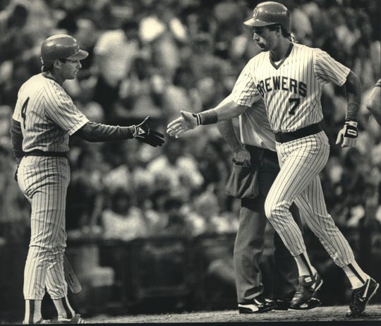 Milwaukee's Dale Sveum (right) received a handshake from Paul Molitor after hitting his first of three homers against the California Angels in 1987.