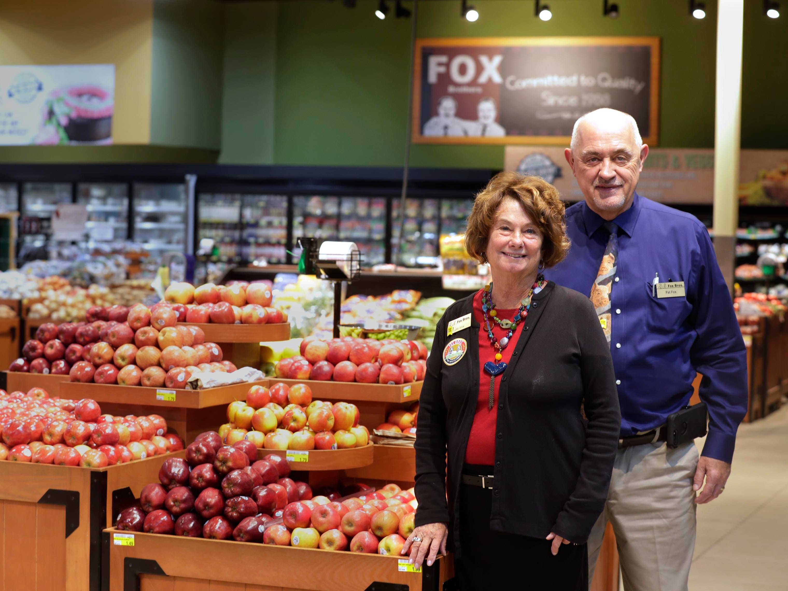 Pat and Lois Fox stand in the Fox Bros. Piggly Wiggly store in Richfield. The chain is purchasing a store in West Bend.