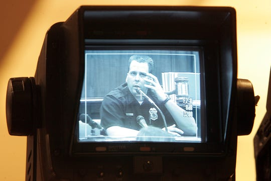 Officer Joseph Schabel is seen in the Court TV monitor as he testified about the scene he encountered when arriving at the Frank Jude beating on Oct. 24, 2004, during the trial of the three officers at the Milwaukee County Courthouse on April 7, 2005. Court TV covered the Jude trial extensively. Schabel, who was not charged in the original trial, later pleaded guilty to two federal felonies in the case.