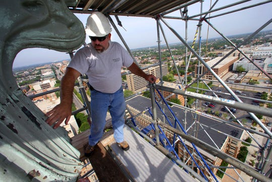 Roger Hamm, a superintendent with Millen Roofing, of Milwaukee, checks on ornamental siding some 260 feet above the ground on the historic Gesu Church steeple at N. 12th St. and W. Wisconsin Ave. in 2012.