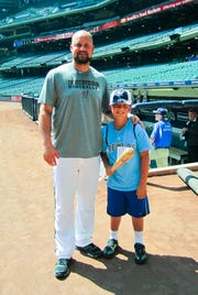 Brewers third baseman Casey McGehee poses with Clayton Wollner, 7, of Sussex, in 2011.