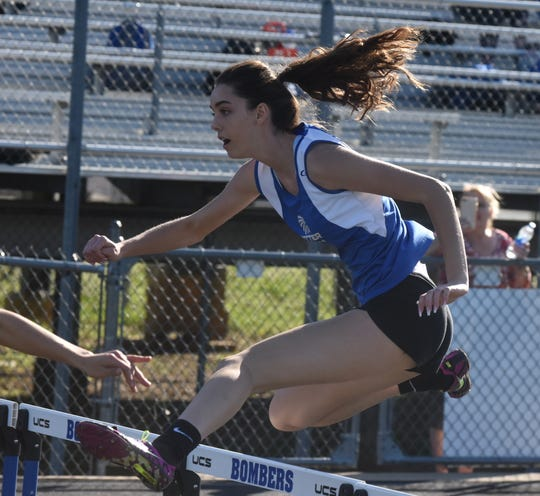 Cotter's Christianne Crunkleton competes in the 100-meter hurdles on Monday.