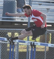Norfork's Eric Olson in the 110 hurdles