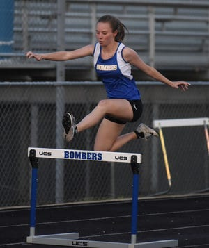 Mountain Home's Danielle Frencl competes in the 300-meter hurdles on Monday night.