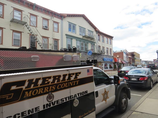 A Morris County Sheriff's Office crime investigation unit is parked on Main Street Monday afternoon following reports of a stabbing in Boonton.