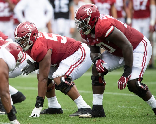 Alabama offensive linemen Emil Ekiyor, Jr., (55) and  Alex Leatherwood (70) during first half action in the Alabama A-Day spring football scrimmage game at Bryant Denny Stadium in Tuscaloosa, Ala., on Saturday April 13, 2019.