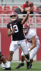 Alabama quarterback Tua Tagovailoa (13) passes during second half action in the Alabama A-Day spring football scrimmage game at Bryant Denny Stadium in Tuscaloosa, Ala., on Saturday April 13, 2019.