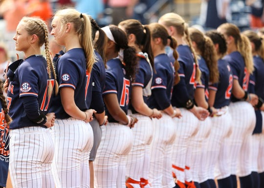 Members of the Auburn softball team stand together.
