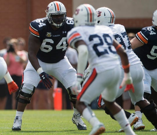 Auburn offensive lineman Mike Horton (64) blocks during the A-Day spring game at Jordan-Hare Stadium in Auburn, Ala., on Saturday, April 13, 2019.