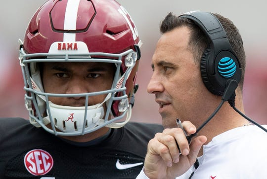 Alabama offensive coordinator Steve Sarkisian  talks with quarterback Tua Tagovailoa (13) during second half action in the Alabama A-Day spring football scrimmage game at Bryant Denny Stadium in Tuscaloosa, Ala., on Saturday April 13, 2019.