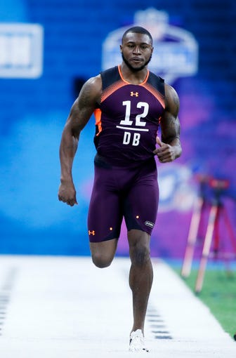 Mar 4, 2019; Indianapolis, IN, USA; Auburn defensive back Jamel Dean (DB12) runs the 40 yard dash during the 2019 NFL Combine at Lucas Oil Stadium. Mandatory Credit: Brian Spurlock-USA TODAY Sports