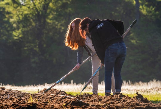 BTW students Erika Lewis, left, and Andy Whipkey work in the school's garden in Montgomery, Ala., before school on Tuesday April 16, 2019.