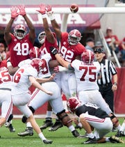 Alabama linemen Phidarian Mathis (48), Stephon Wynn, Jr., (90) and Justin Eboigbe (92) try too block a field goal during first half action in the Alabama A-Day spring football scrimmage game at Bryant Denny Stadium in Tuscaloosa, Ala., on Saturday April 13, 2019.