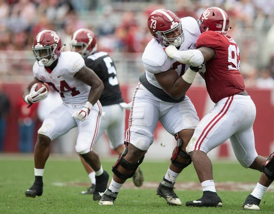 Alabama offensive lineman Evan Neal (73) goes against Alabama defensive lineman Justin Eboigbe (92) during second half action in the Alabama A-Day spring football scrimmage game at Bryant Denny Stadium in Tuscaloosa, Ala., on Saturday April 13, 2019.