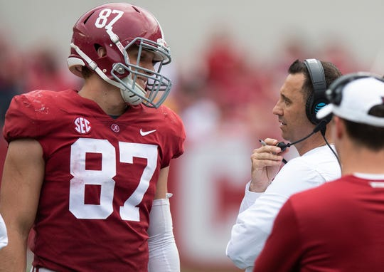 Alabama offensive coordinator Steve Sarkisian talks with tight end Miller Forristall (87) during second half action in the Alabama A-Day spring football scrimmage game at Bryant Denny Stadium in Tuscaloosa, Ala., on Saturday April 13, 2019.