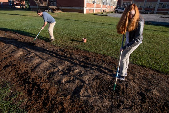 BTW teacher Foster Dickson and student Erika Lewis work in the school's garden in Montgomery, Ala., before school on Tuesday April 16, 2019.