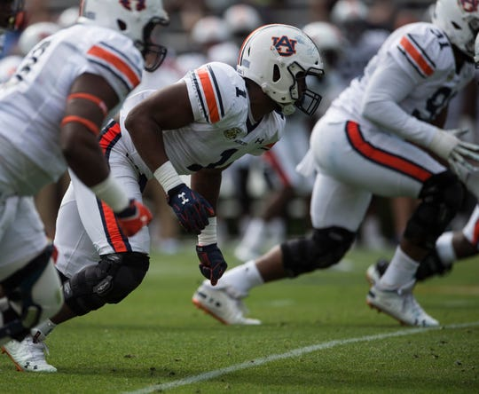 Auburn defensive lineman Big Kat Bryant (1) rushes the line during the A-Day spring practice game at Jordan-Hare Stadium in Auburn, Ala., on Saturday, April 13, 2019.